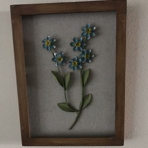 Brown wooden frame with blue metal flowers